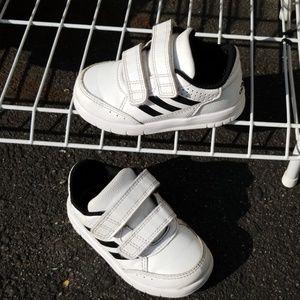 Adidas white sneakers.